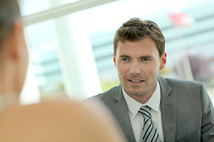 Portrait of handsome businessman talking to business partner